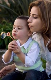 Mom and child blowing bubbles