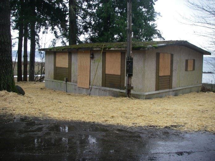 House boarded up and trash gone at Highway 101 property after successful cleanup