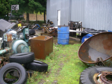 Tires and junk at Center Road property before successful cleanup