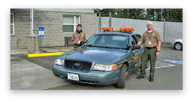 Volunteer in Police Services Program Participants Next to Sheriff Vehicle