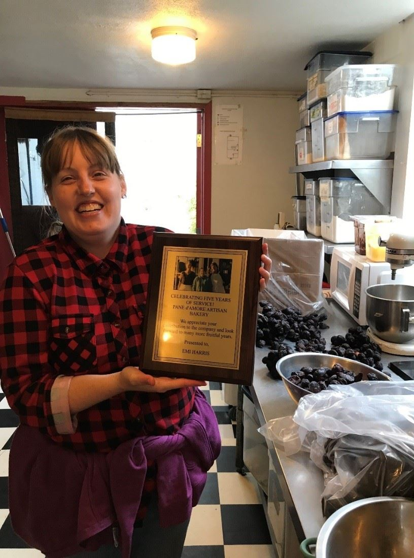 Above is a photo of Emi Harris, who received a Plaque of Appreciation from Pane d'Amore for five years of employment.